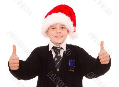 Happy smiling school boy in Santa hat.