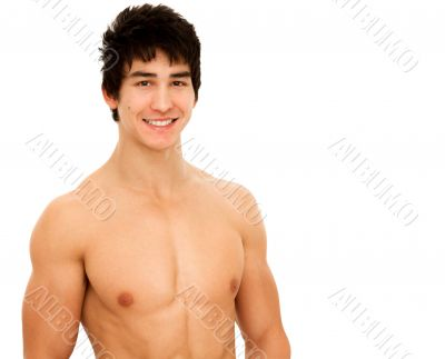 Smiling young man with muscular and tanned naked torso.