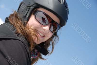 Portrait of a smiling young woman wearing ski helmet