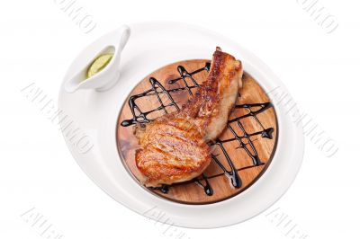 a piece of grilled meat on a wooden board