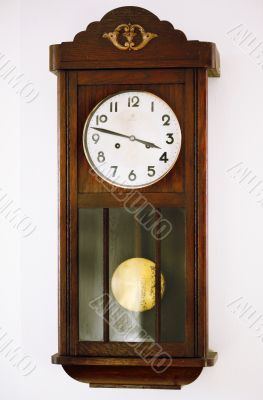 old grandfather's clock with pendulum