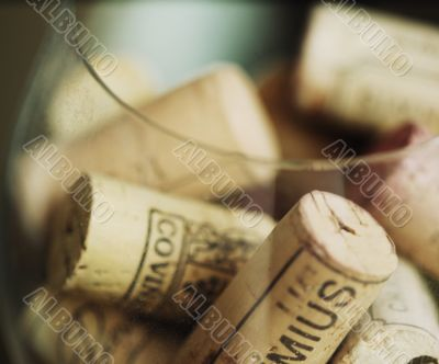 Corks from wine in a big wineglass