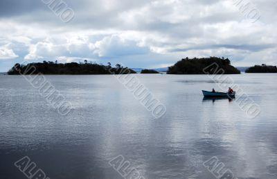 Two men in a boat in bay