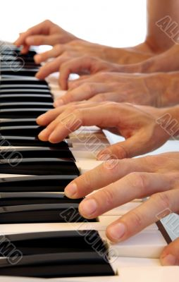 Six hands on grand piano