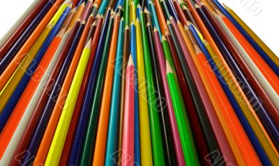 many colored pencils pointing up