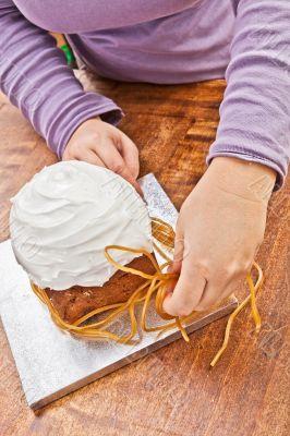 Woman decorating christmas cake