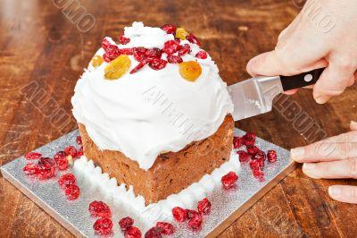 Cutting christmas cake