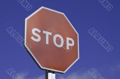 Stop Sign close up on blue sky