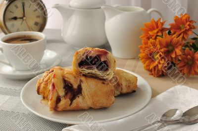 Morning cup of coffee and freshly baked cakes with cherries