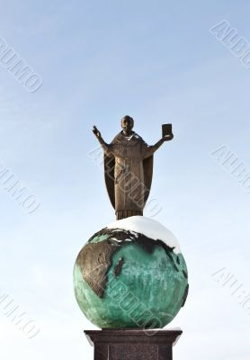 Religious sculpture - man in the mantle on the globe