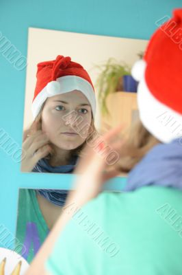 Looking into the mirror - woman with santa hat -