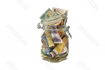 Old banknotes in a glass jar