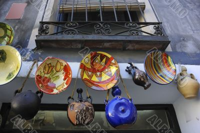 Many handcraft are exposed out of a shop in spain