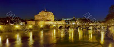 Bridge, castel Sant`angelo and Tiber river at dawn