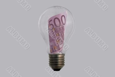 The concepts of money and energy are encased in a light bulb