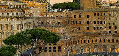 Modern and ancient buildings in Rome at sunset