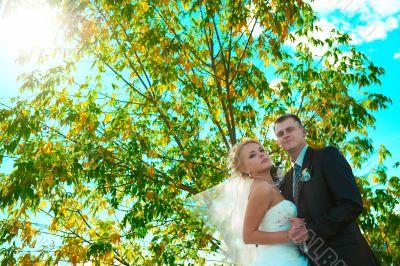 Bride and groom of blue sky