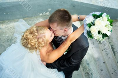 Bride and groom at the stairs