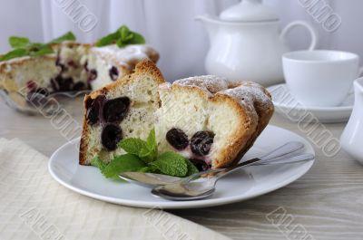 Pieces of sponge cake with cherries