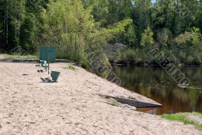 Beach on the shore of the pond.