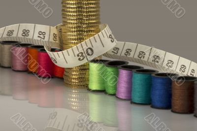 Tailoring costs represented by coins, threads and meters
