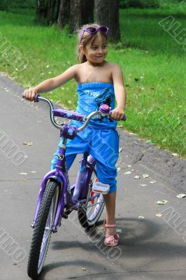 6 years old girl riding a bicycle.