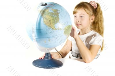 Beautiful little girl with a globe