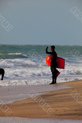 Bodyboader and surfer