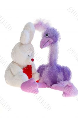 Toy teddy bear, ostrich and rabbit together.
