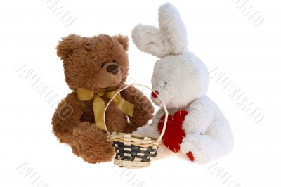 Toy teddy bear and a rabbit with a basket.