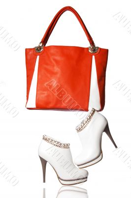 A pair of women`s ankle boots and handbag