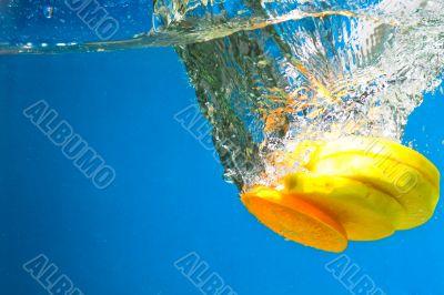 Citrus slice SPLASHING IN WATER