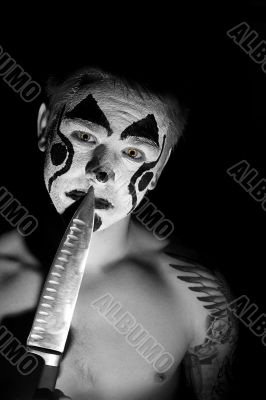 Evil clown with a knife