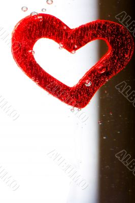 Valentine with red heart in water
