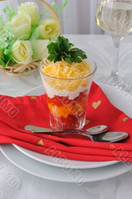 Salad of red and yellow tomatoes with mayonnaise and cheese