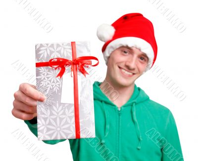 Man with santa hat holding christmas present