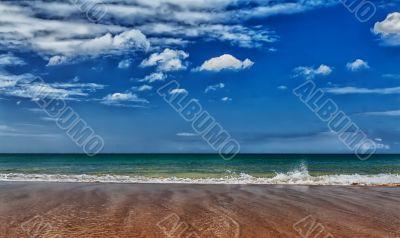 A tropical beach with blue sea
