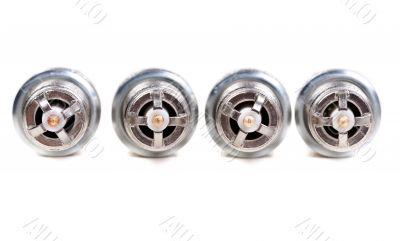 Four automobile spark plugs