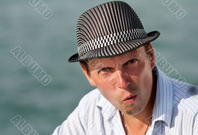 portrait of a man in a hat amazed