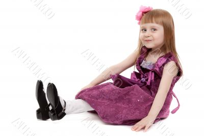 Four-year girl sitting on white floor