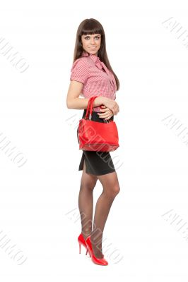 Full-length portrait of a girl with a fashionable red leather ha