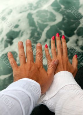 Men`s and Women`s tanned hands