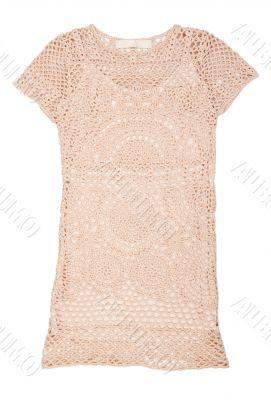 Knitted women`s dress in beige mesh