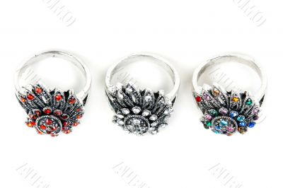 Three silver rings with precious stones