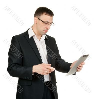 businessman with a tablet PC at a loss