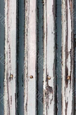 A background of closeup weathered white painted wood