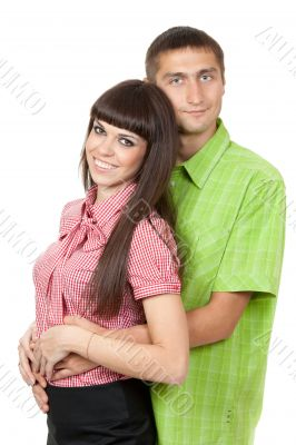 Beautiful couple in colored clothing. Studio portrait, isolate o