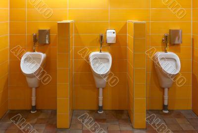Three urinal in the bathroom