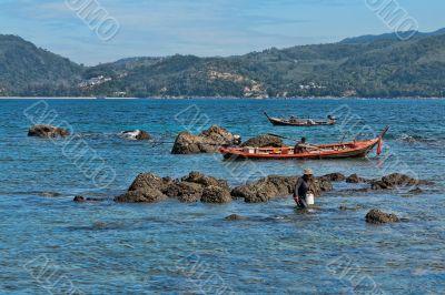 Thai fishermen catch fish