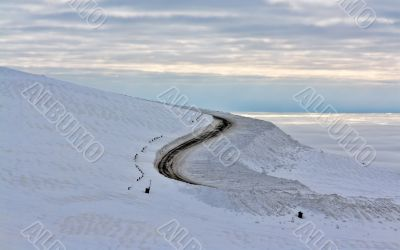Dirt road in the snowy mountains